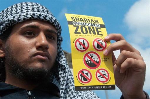 Sharia-police con volantino di zona controll.